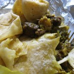03 digging into the roti curry goat and potatoes 150x150 Curry Goat Roti