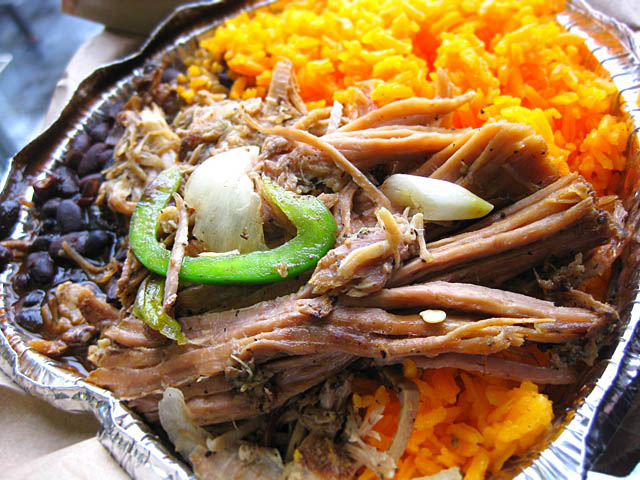 01 milanes restaurant pernil pork shoulder with rice and beans Milanes Pernil Pork Shoulder